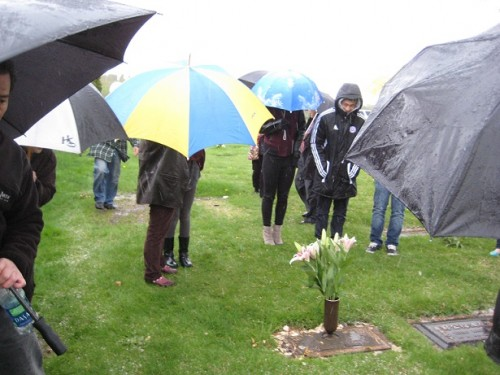 Family visits the grave of their Mother
