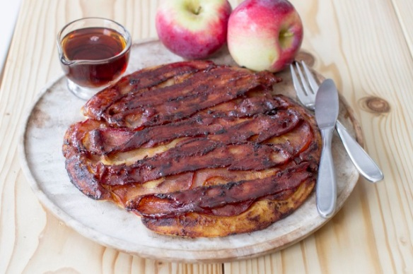 Matthew Mead/THE ASSOCIATED PRESS This bacon-apple pancake has it all — taking inspiration from upside-down cake and blending savory and sweet flavors.