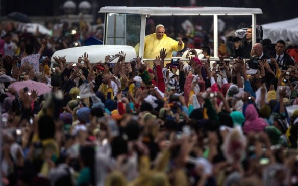 Pope Francis waves to the crowd after conducting mass at the Rizal Park. Picture: GETTY
