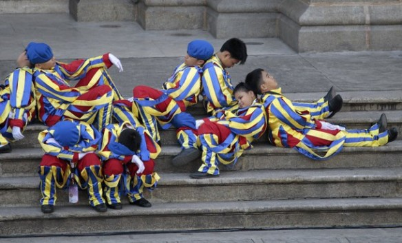 Young boys dressed as Swiss Guards rest as they wait for the arrival of Pope Francis at the Cathedral Basilica of the Immaculate Conception in Manila, Philippines. Picture: AP Photo/Wally Santana