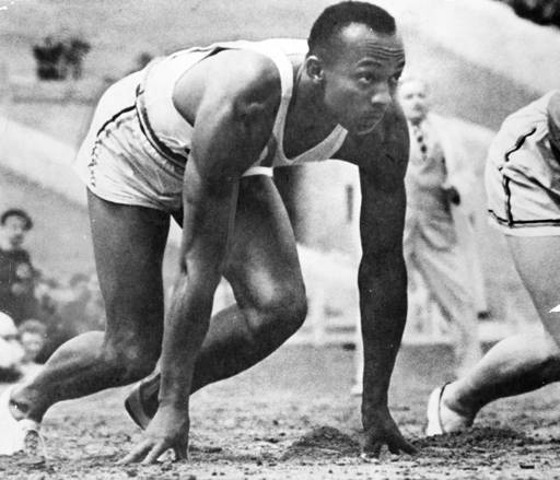 Olympic-sprinter-Jesse-Owens-awaits-the-start-of-a-race-at-the-1936-Olympic-Games-in-Germany.