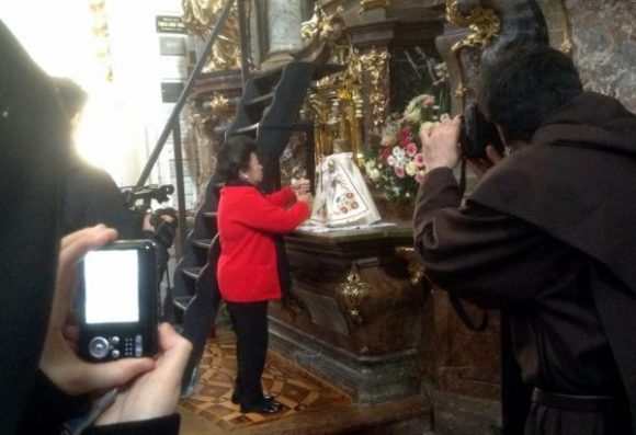 My sister, Susan P. Hauck changing the clothing of Infant Jesus in Prague